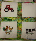 PERSONALISED EMBROIDERED CUSHION WITH FARM THEME - (Red Tractor, Hens and a cow)